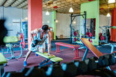 Bodybuilder working out and training at the gym — Stock Photo