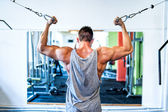 Bodybuilder working out the biceps in the gym. Sports concept — Stock Photo