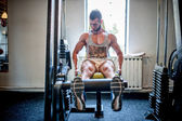 Bodybuilder working out and training at the gym, legs and feet program — Stock Photo