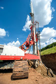 Industrial drilling rig at construction site making holes and drilling — Stock Photo