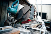 Industrial metal cutting tool in factory, sliding compound mitre saw with sharp blade. steel and metal manufacturing — Stock Photo