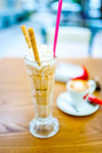 Iced coffee, frappe, with whipped cream, almonds cream and cookie — Stock Photo