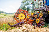 Agricultural activities with combine harvesting machine in wheat crops — Stock Photo