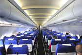 Interior of an airplane with passenger — Stock Photo