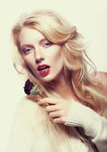 Pretty female face. Blond long hair. Red flower - rose — Stock Photo