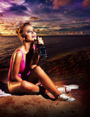 Young beautiful fashion woman in depression drinking alcohol — Stock Photo
