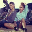 Travel destination. Young couple relaxing on beach — Stok fotoğraf