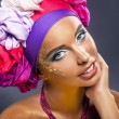 Colorful shawl. Pretty woman face - bright gold make up — Stock Photo