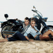Couple resting on beach - travel destination — Stockfoto