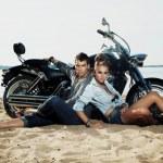 Couple resting on beach - travel destination — Stock Photo