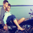 Stock Photo: Romantic couple family resting on lake shore - motorbike