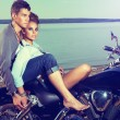 Romantic couple family resting on lake shore - motorbike — Stock Photo