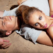 Stock Photo: Portrait of beautiful young couple resting - satisfaction