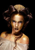 Woman gilded golden face - theater luxury make up — Stock Photo