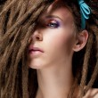 Stock Photo: Dreadlocks. Fashion hairstyle with dreads - beauty womface