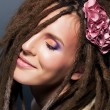 Dreads coiffure. Emotions. Fashion female  hairstyle. Flower — Stock Photo