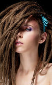 Dreadlocks. Fashion hairstyle with dreads - beauty woman face — Stock Photo
