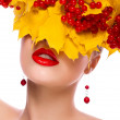 Stock Photo: Autumn beauty woman. Beautiful makeup. Yellow leaves, berries