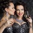 Stock Photo: Christmas. Fashion women with wine glasses of champagne