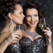 Christmas. Fashion women with wine glasses of champagne — Stock Photo