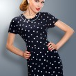 Pin-up girl in retro vintage old-fashioned dress posing — Stock Photo