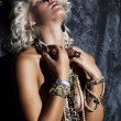 Topless young woman blonde with necklace in erotic pose dreaming — Stock Photo