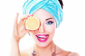 Cheerful young woman holding juicy delicious lemon (orange) — Stock Photo