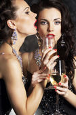 Women - happy new year with wineglasses of champagne — Stock Photo