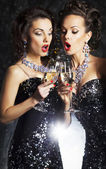 Couple of cheerful women toasting at party with wineglasses celebrating — Stock Photo