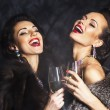 Stock Photo: Young happy fashion women celebrating the event. Congrats!