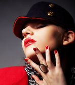 Portrait of beautiful glamorous young woman in stylish cap — Stock Photo