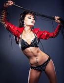 Fantasy. Sexy stripper dj in nightclub with lash. Erotic pose — Stock Photo