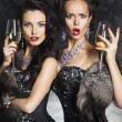 Stock Photo: Fashion women drinking champagne in nightclub. Merry Christmas!