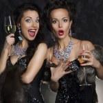 Couple of women celebrating birthday in restaurant. Holidays — Stock Photo