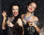 Young women in black elegant dress with champagne - nightlife — Stock Photo
