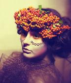 Fairy tale. Floristics. Woman in wreath of rowan berry - grunge — Stock Photo