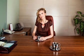 Attractive businesswoman boss siting at office desk - smile — Stock Photo