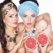 Women holding Grapefruits in hands - Diet and Nutrition concept — Stock Photo