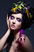 Fantasy. Fashion Female with Colorful Feathers - Bright Makeup — Stock Photo