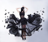 Swing. Sensual Woman in Black Fluttering Dress with Butterflies — Stok fotoğraf
