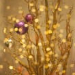 Christmas Tree Decoration - Glittering Golden Bokeh Background - Stock Photo