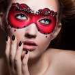 Painted Face. Beautiful Girl in Red Carnival Mask. Masquerade — Stock Photo