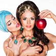 Sensuality. Women Hugging and Holding Red Apple - 图库照片