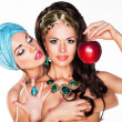 Sensuality. Women Hugging and Holding Red Apple - Foto Stock