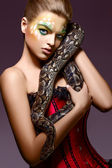Beautiful Woman holding Python Snake in Hands - Performance — Stock Photo