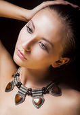 Adorable Woman with Metallic Necklace and Amber. Natural Makeup — Stock Photo