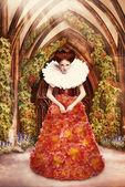 Kızıl saçlı düşes kırmızı elbise ve jabot eski manastırda — Stok fotoğraf