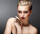 Beautiful Girl Holding Live Tamed Spider in her Hand — Stock Photo