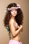Sultry Beauty. Attractive Naked Woman with Long Curly Hair and Wreath of Flowers — Stock Photo