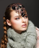 Braided Hair Luxurious Woman in Fur Collar and Gemstones. Jewels — Stock Photo